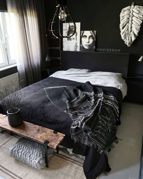 a Nordic bedroom with black walls, a chic bedding set, artworks and white touches