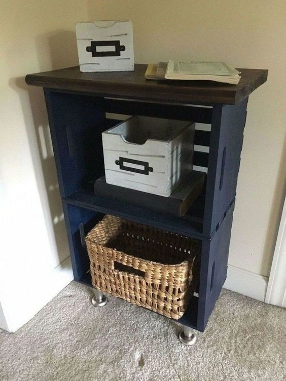 a small entryway console of navy crates, a dark stained tabletop and metal legs is a very cool idea for a small space