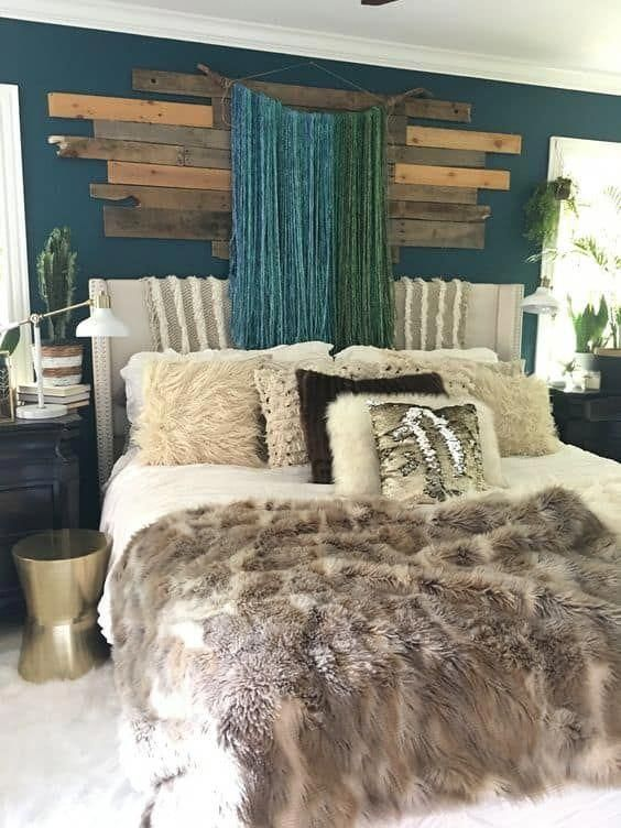 faux fur thrwos and blankets cozy up the bedroom for the fall and coming winter