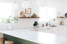 15 white glass bubble pendant lamps continie the decor style of the kitchen giving it a light feeling