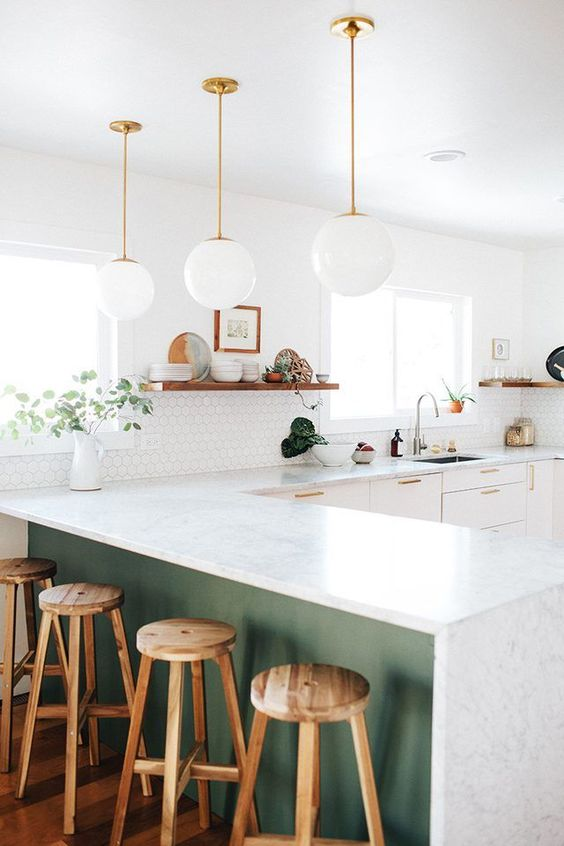 white glass bubble pendant lamps continie the decor style of the kitchen giving it a light feeling