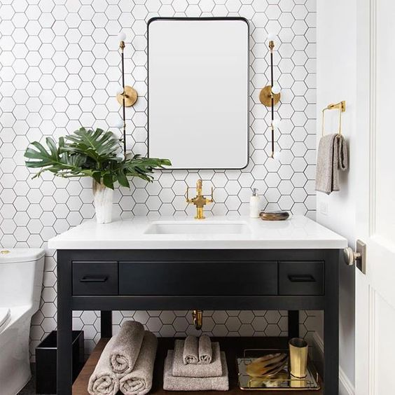 white hex tiles with black grout will make your black and white space non-boring