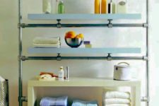 16 Ikea Lack shelves and galvanized pipes and fittings turned into a stylish and chic shelving unit for a large bathroom