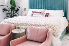16 a beautiful blue upholstered headboard is soft and chic, and light pink chairs continue the pastel tone of the space