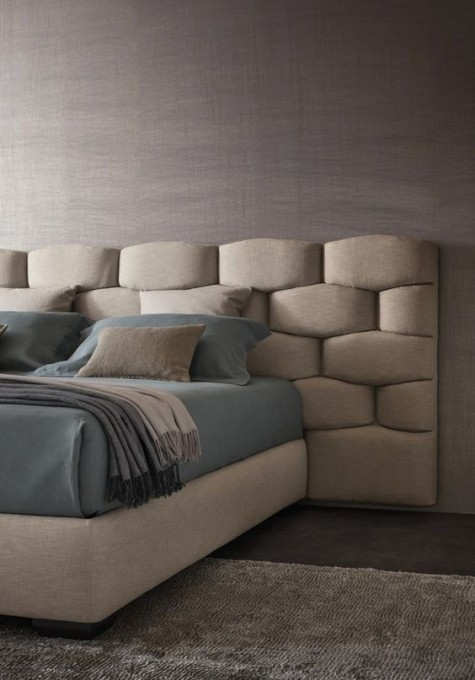 a creative textural padded headboard that takes some space around looks ultra modern and bold