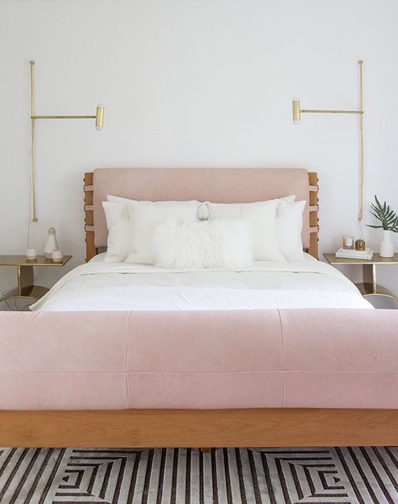 a pink leather upholstered headboard and foot of the bed make up a unique look