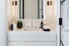 16 cool contemporary wall lamps on both sides of the mirror are ideal to lit up this small nook