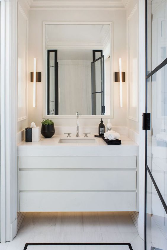 cool contemporary wall lamps on both sides of the mirror are ideal to lit up this small nook