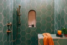 16 green hex tiles with copper grout make up a chic and bold bathroom space