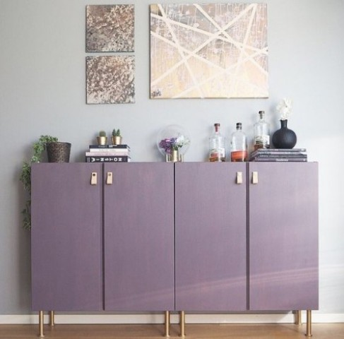 plain Ivar cabinets turned into a stylish home bar in purple, with copper legs and leather pulls