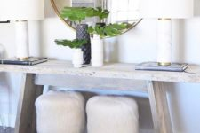 16 two little stools covered with white faux fur will add a chic and cozy touch to the space