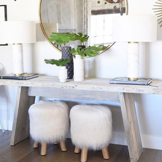 two little stools covered with white faux fur will add a chic and cozy touch to the space