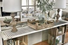 17 a farmhouse console table made of wooden crates and a shutter looks very rustic and relaxed