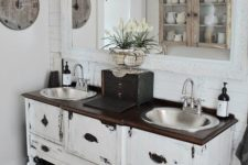 17 a shabby chic vanity space with adorable vintage pendant lamps over the vanity that add a refined touch