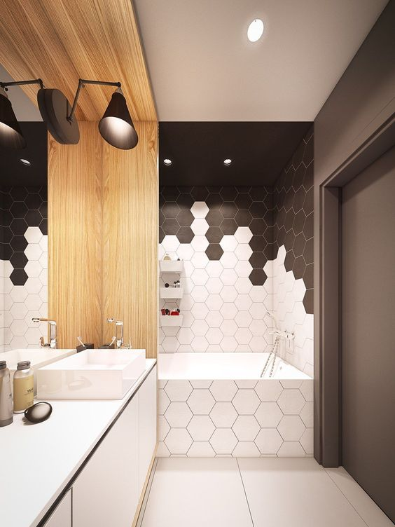chic black and white hex tiles with conttrasting grout make up a chic geometric bathroom
