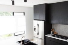 17 track lighting is a bold modern idea for any kitchen, it's very chic and very functional bringing much light