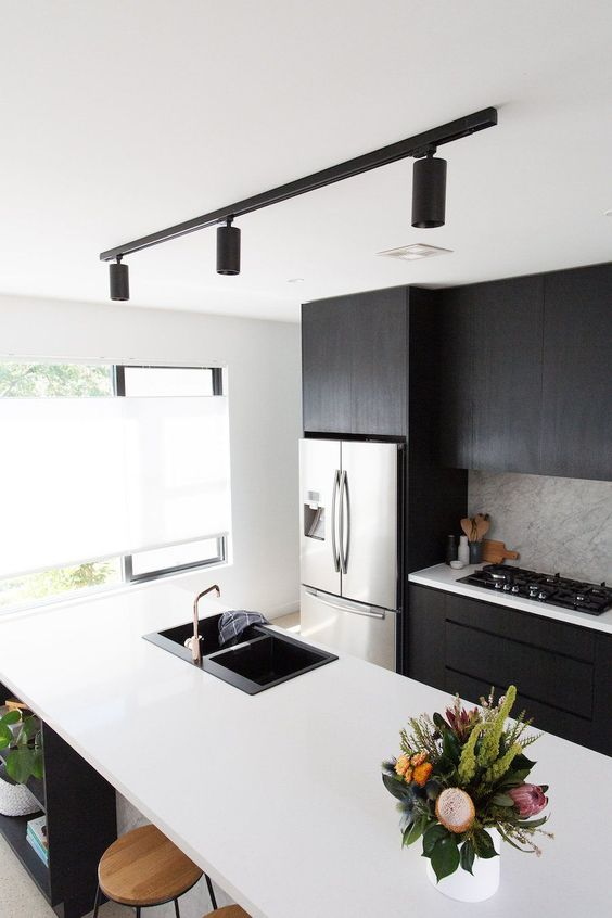 track lighting is a bold modern idea for any kitchen, it's very chic and very functional bringing much light
