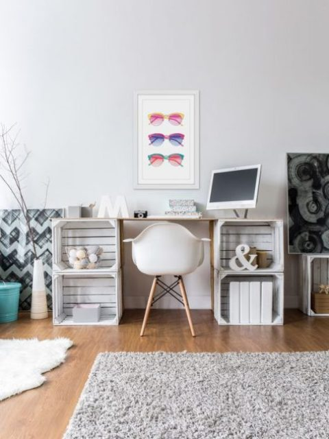 a cute and simple desk of whitewashed crates and a neutral tabletop for a relaxed space