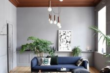 18 a statement modern chandelier featuring multiple bulbs with copper touches