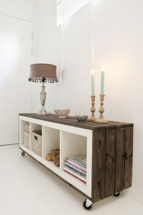 an IKEA Expedit shelf covered with weathered wood and put on casters looks super cool