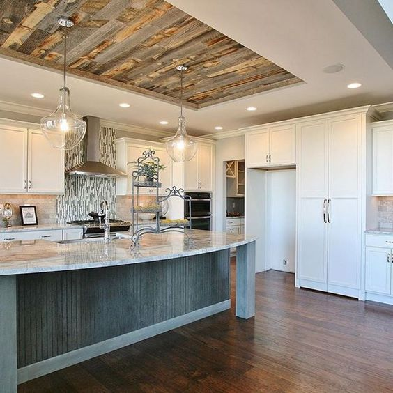 ceiling lights combined with elegant chandeliers over the kitchen island to get enough light