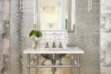 18 small scale reflective tiles that reflect the lamp light and look very shiny and statement-like
