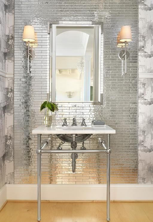 small scale reflective tiles that reflect the lamp light and look very shiny and statement-like