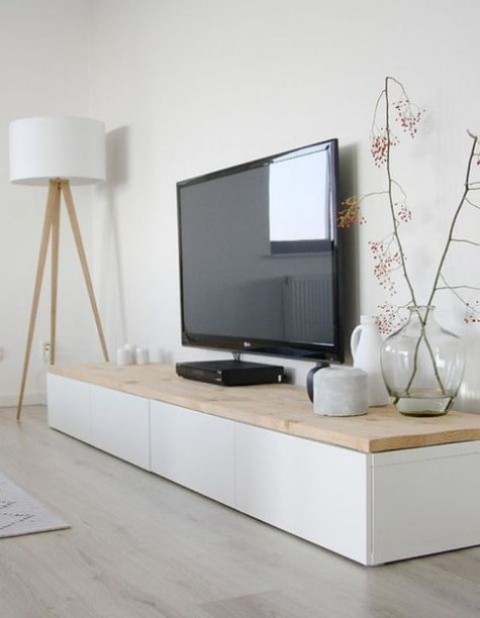 a TV unit of IKEA Besta and a light stained wooden countertop is a perfect fit for a Scandinavian room