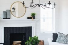 19 a black chanddelier imitating old candle ones contrasts the neutral space and adds drama
