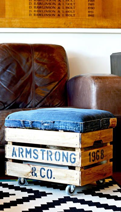 a crate denim ottoman on casters is a fun idea to add a rustic feel to the space