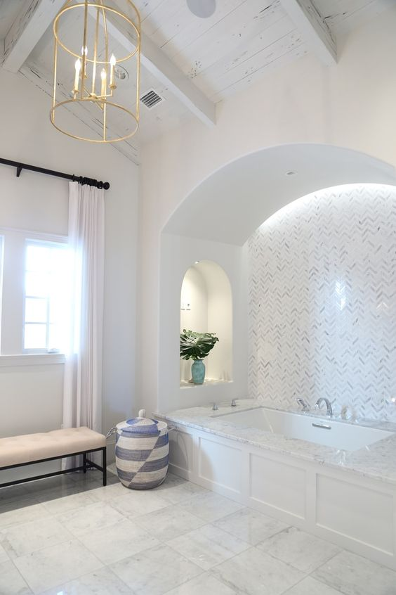 lights built in over the tub and in the niches make the bathing space cozier and comfier