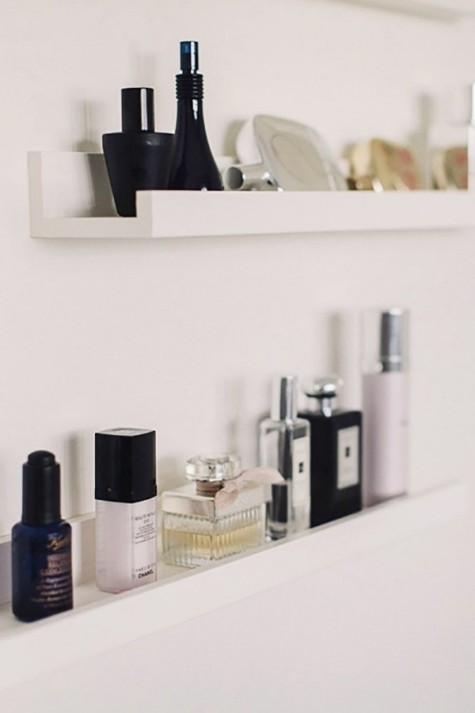 Mosslanda picture ledges used for storing small things in your bathroom - ideal for makeup