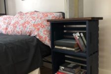 20 a modern farmhouse nightstand of black crates, a stained tabletop and metal legs is a chic idea