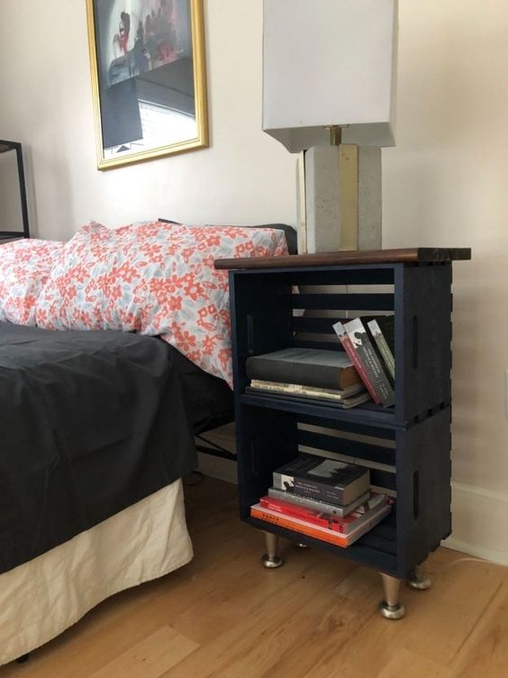 a modern farmhouse nightstand of black crates, a stained tabletop and metal legs is a chic idea