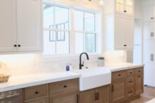 20 wall lamps and ceiling lights plus lights over the countertops make the kitchen look very bright