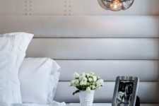 21 a glass pendant lamp with an eye-catchy shape and gold touches spruces up a neutral bedroom