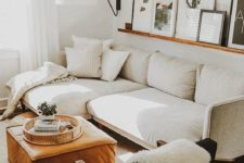 21 a large wall sconce with a lampshade adds coziness to the living room
