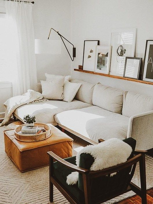 a large wall sconce with a lampshade adds coziness to the living room