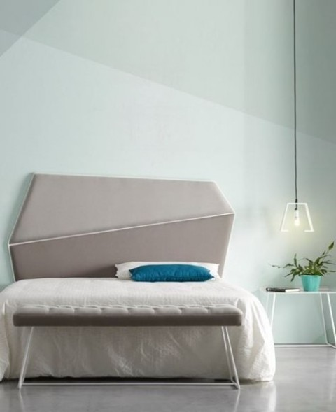 a modern asymmetrical geometric upholstered headboard in two shades of grey leather si a chic accent in the bedroom