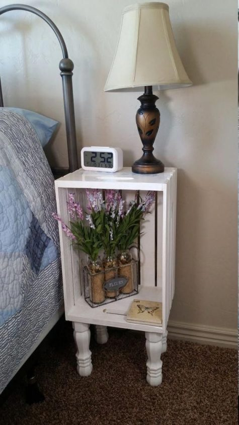 a nightstand made of a white crate and vintage legs will easily fit a refined space with a vintage feel