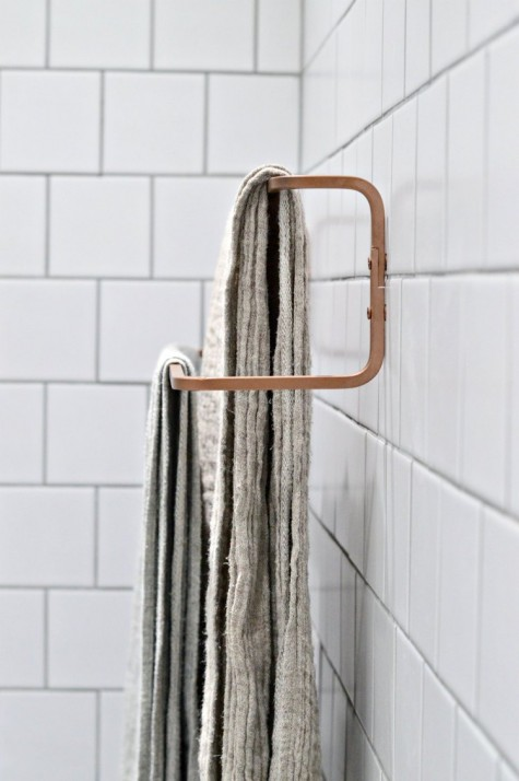 an Ikea Hjalmaren towel rail spray painted copper for a more chic look will fit a contemporayr bathroom