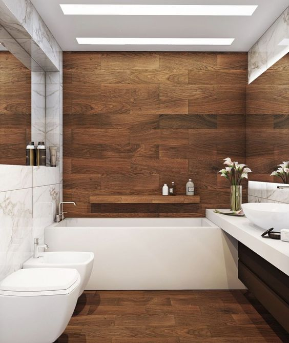 built-in lights over the tub won't take much space and look very sleek and elegant in this contemporary space