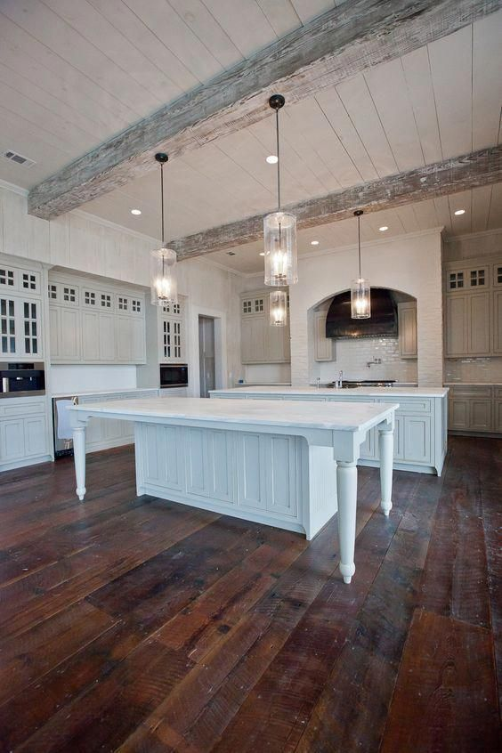 ceiling lights and original pendant lamps modernize the farmhouse kitchen done in white