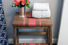 22 a convenient tub-side storage unit of an Ikea Bekvam stool spruced up with a bit of coral paint and a stencil