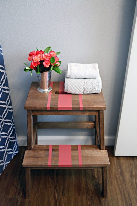 a convenient tub-side storage unit of an Ikea Bekvam stool spruced up with a bit of coral paint and a stencil