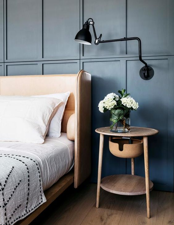 a sleek amber leather wingback headboard is a chic idea that adds coziness to the bedroom