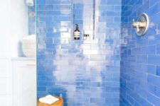 22 bright blue tiles and hex ones with blue floral accents that highlight the color of the walls