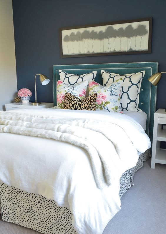 a teal headboard with framing and decorative nails is a touch of color for your glam bedroom