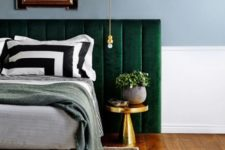 23 an emerald velvet padded headboard and brass accents that make the color stand out even more
