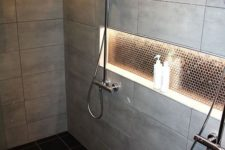 23 some built-in shower lights on the ceiling and a lit up niche for a cozy feel in the shower